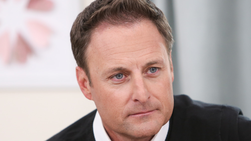 Chris Harrison sitting during an interview