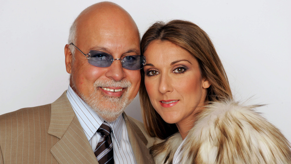 Rene Angelil and Céline Dion posing for a photo