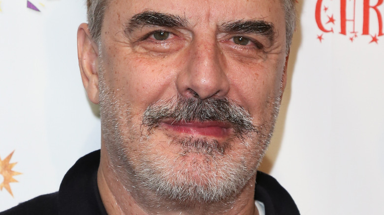 Chris Noth posing at an event