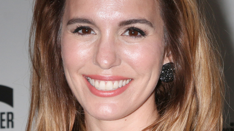 Christy Carlson Romano with wide smile on the red carpet