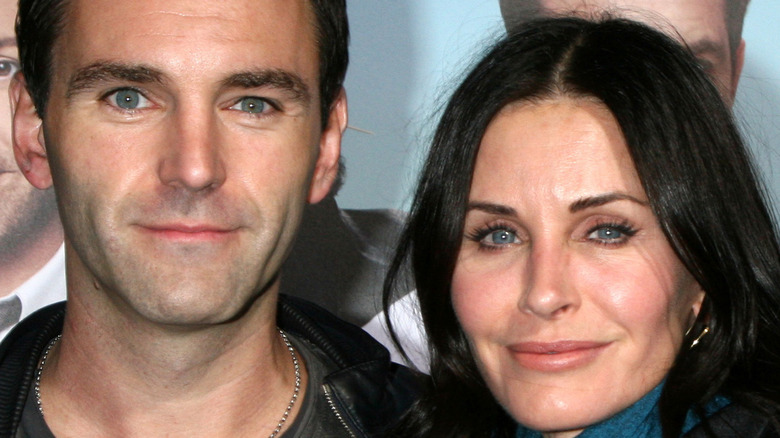 Johnny McDaid and Courteney Cox smiling
