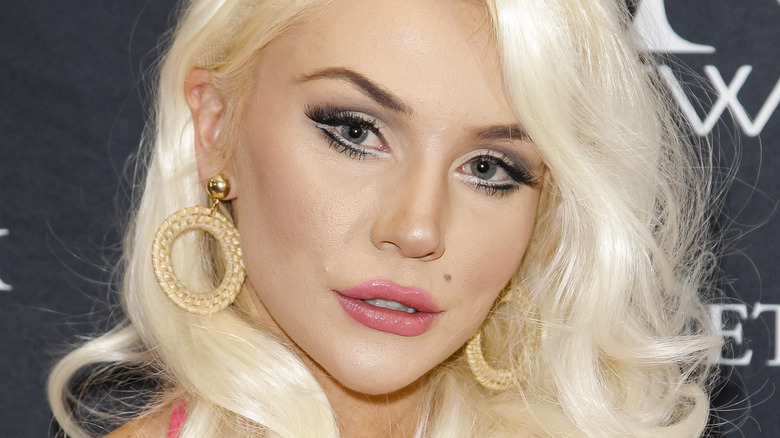 Courtney Stodden poses in a pink dress.