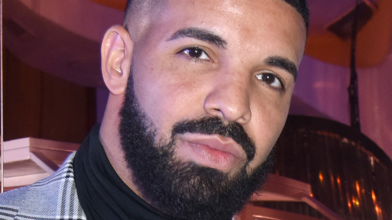 Drake wearing a suit