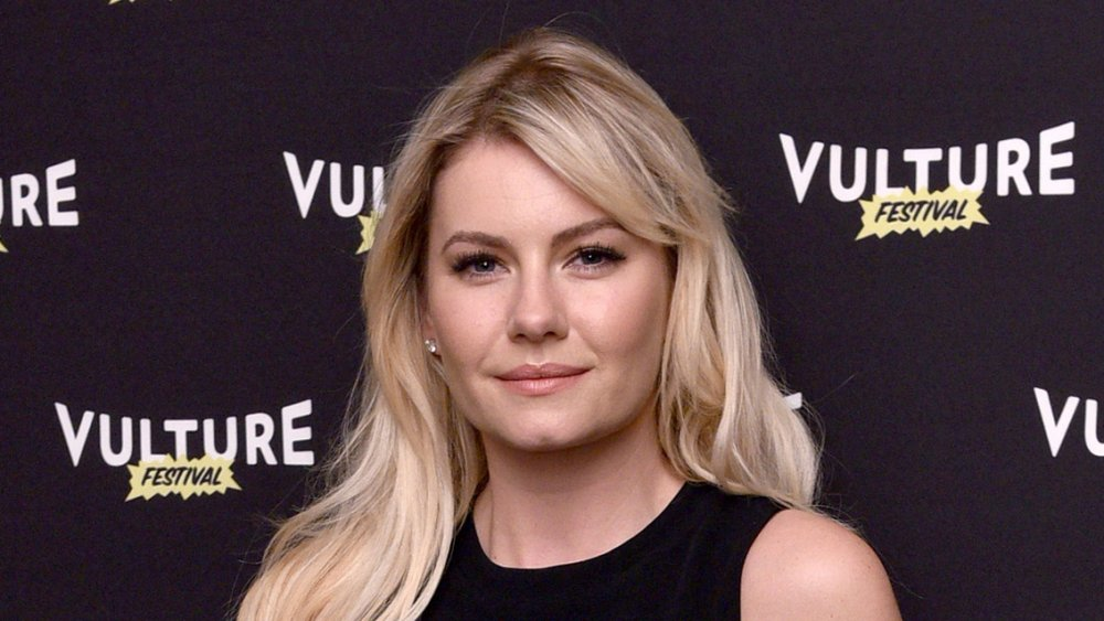 Elisha Cuthbert in front of Vulture Festival wall