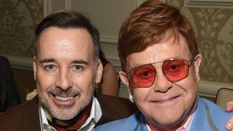 Elton John and David Furnish smiling