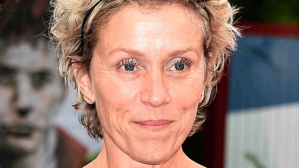 Frances McDormand smiling on the red carpet