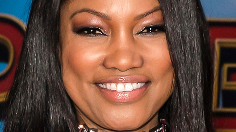 Garcelle Beauvais smiling on red carpet
