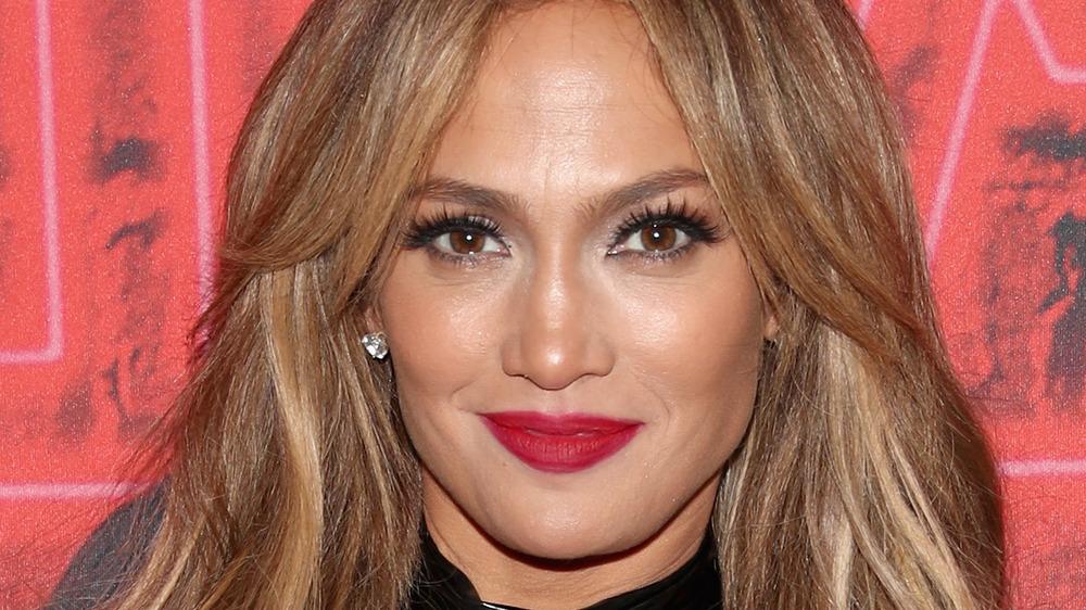 Jennifer Lopez wearing red lipstick at an event