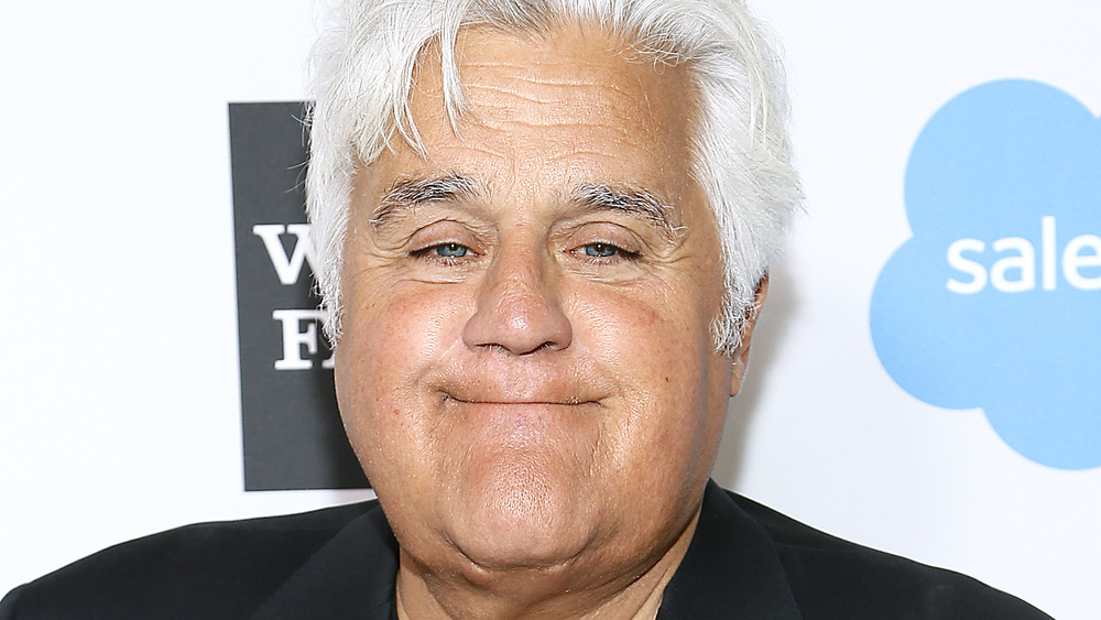 Jay Leno smiling on the red carpet
