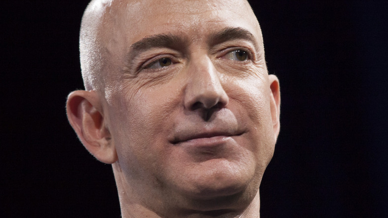 Jeff Bezos smiles on stage