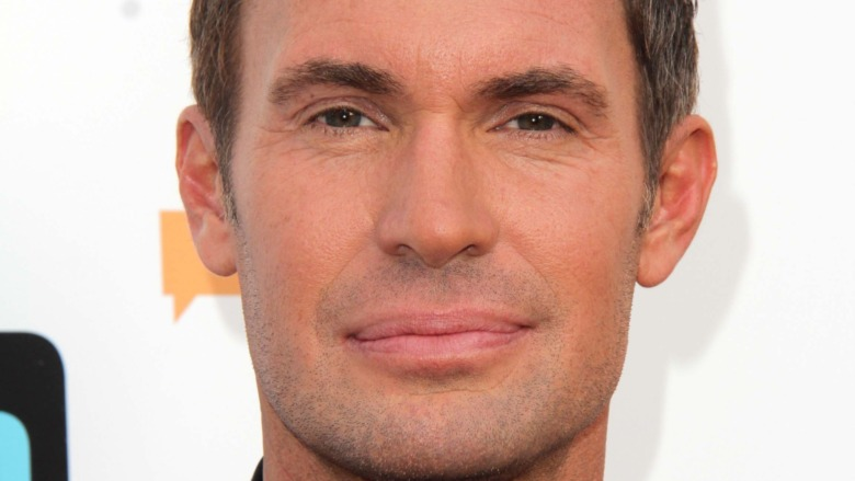 Jeff Lewis in front of a Bravo backdrop
