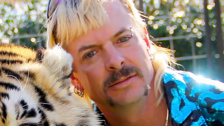 Joe Exotic hugging a tiger
