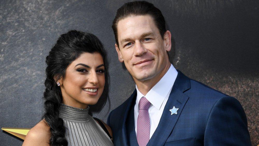 Shay Shariatzadeh and John Cena smiling on the red carpet