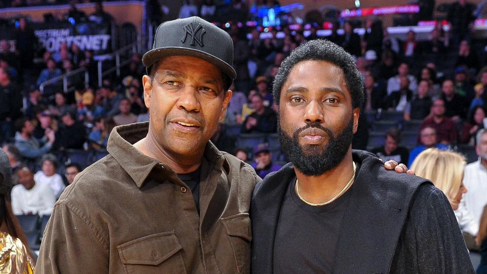 Denzel Washington and John David Washington at a basketball game