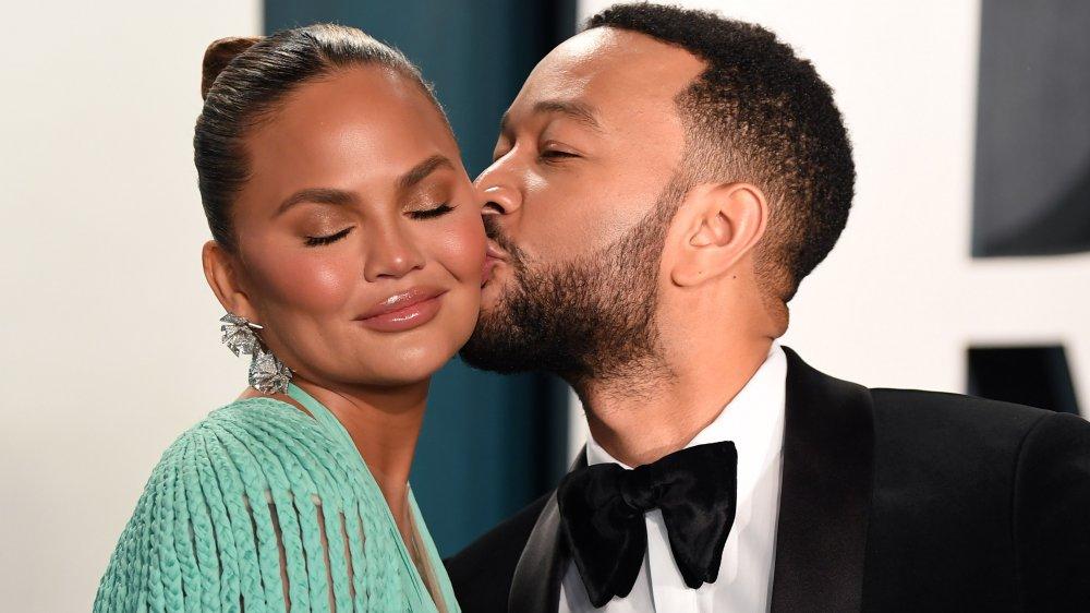 John Legend kissing Chrissy Teigen's cheek