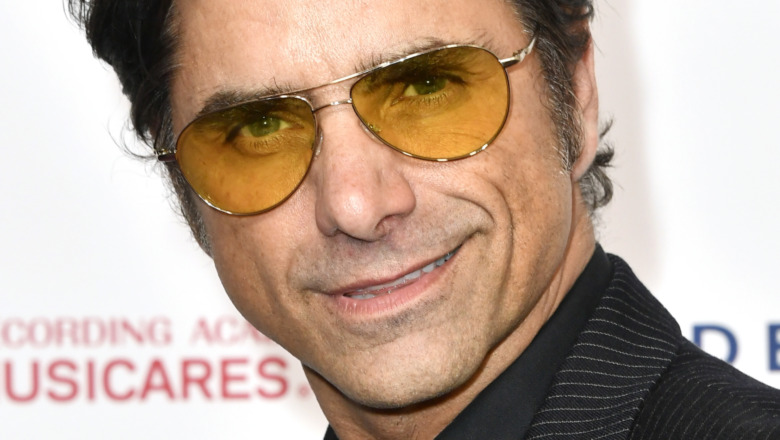 John Stamos wearing sunglasses