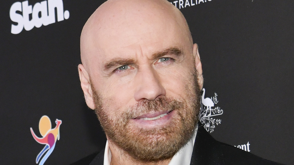 John Travolta poses for a photo on the red carpet