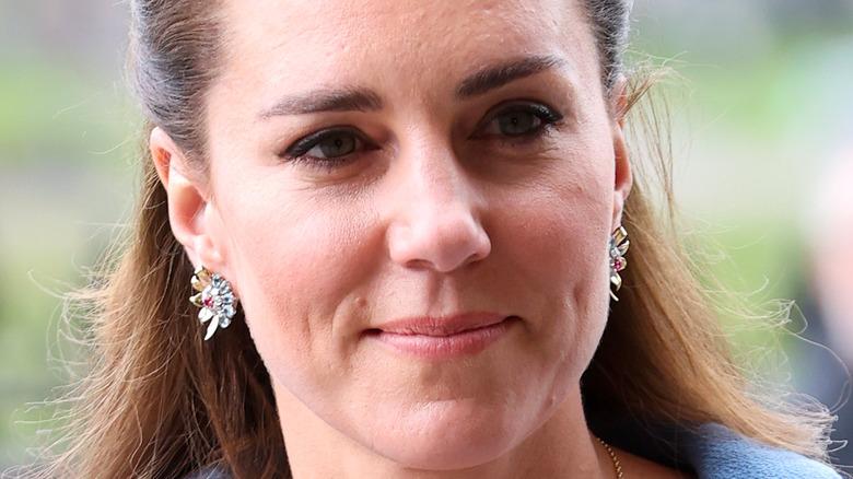 Kate Middleton, half smiling