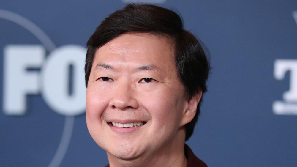 Ken Jeong smiling on the red carpet