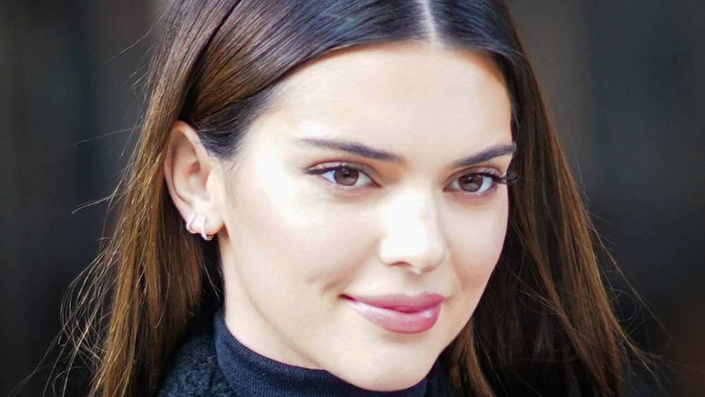 Kendall Jenner smiles as she steps out in public