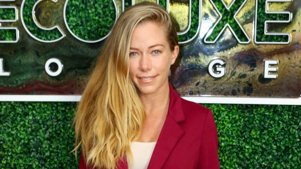 Kendra Wilkinson smiling and posing at an event