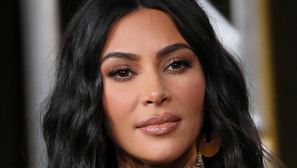 Kim Kardashian looks serious during an interview