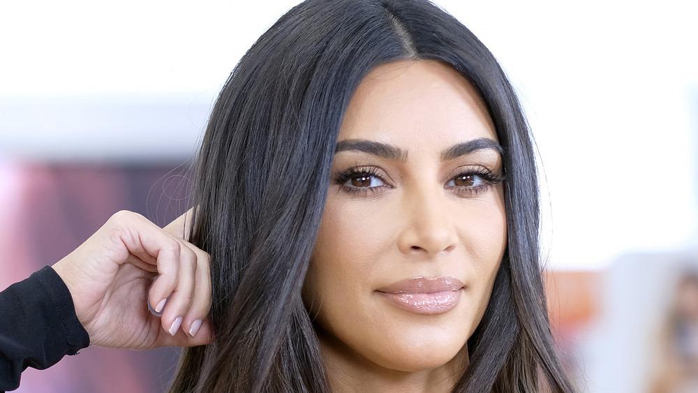 Kim Kardashian posing at a KKW event