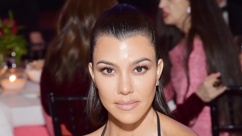 Kourtney Kardashian posing at an event