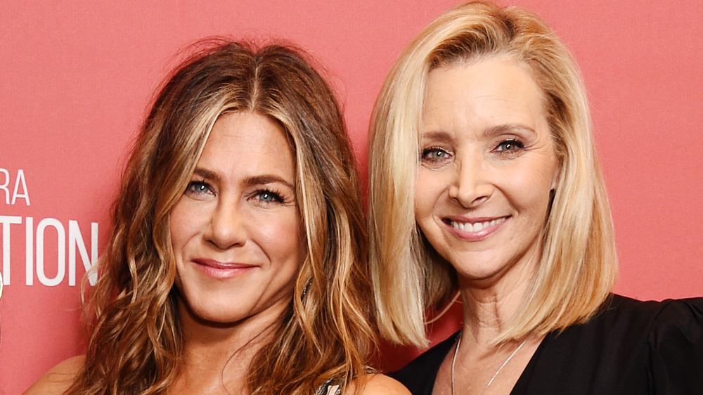 Jennifer Aniston, smiling, red carpet, long hair; Lisa Kudrow, smiling, blond bob, black shirt