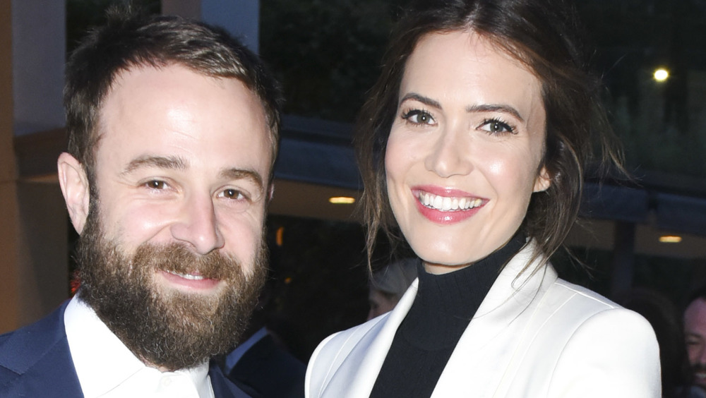 Taylor Goldsmith and Mandy Moore both smiling