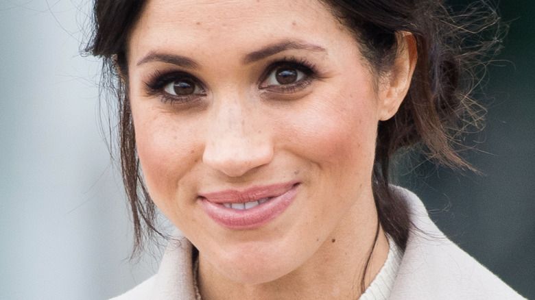 closeup of Meghan Markle smiling at the camera