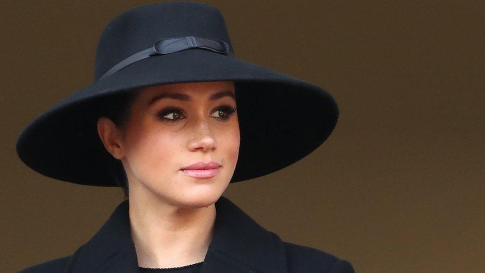Meghan Markle in a large black hat