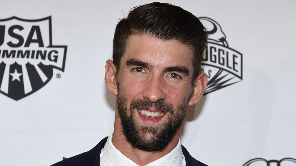 Michael Phelps smiling on the red carpet