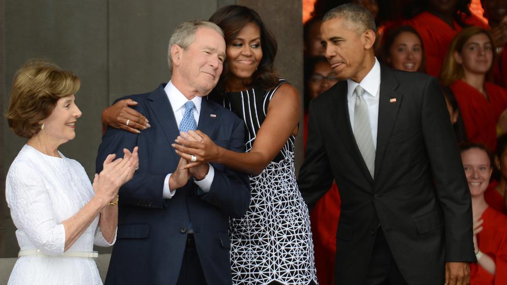 Michelle hugs George Bush