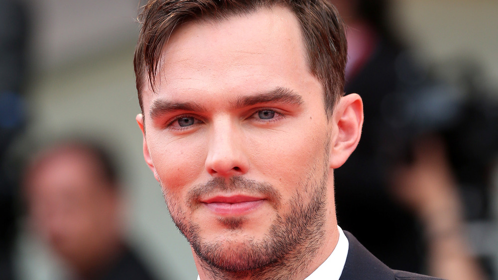 Nicholas Hoult poses at an event
