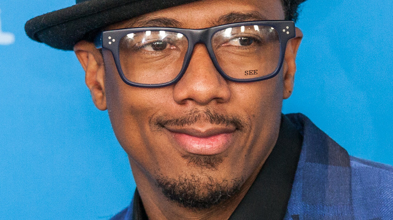 Nick Cannon wearing glasses and hat