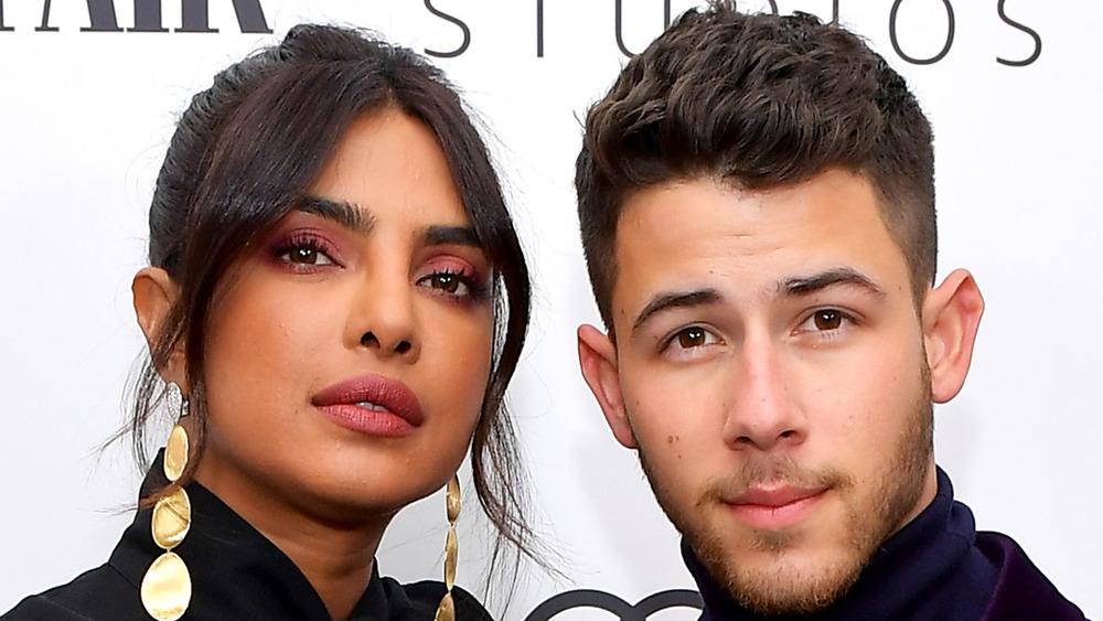 Priyanka Chopra and Nick Jonas pose at a Vanity Fair party