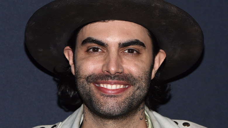 Niko Moon smiling in hat