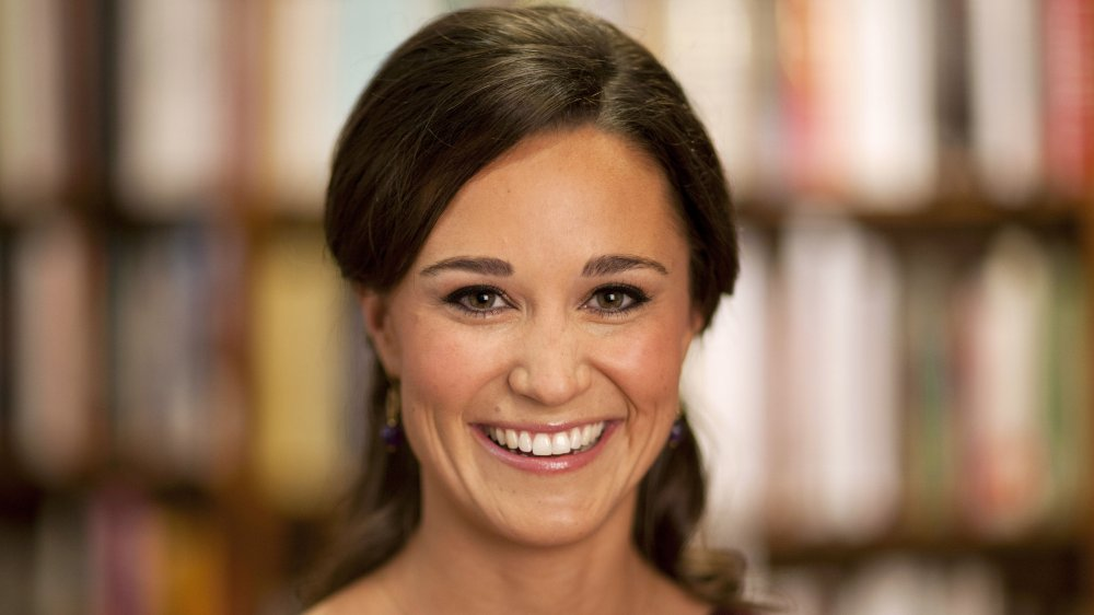 Pippa Middleton smiling while looking straight at camera