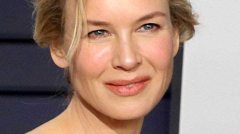 Renee Zellweger smiling and looking to the side