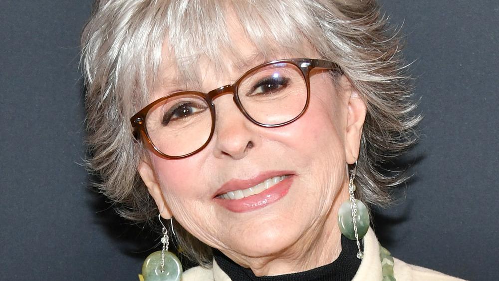 Rita Moreno posing in glasses