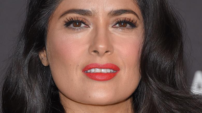 Salma Hayek slightly smiling and looking at camera