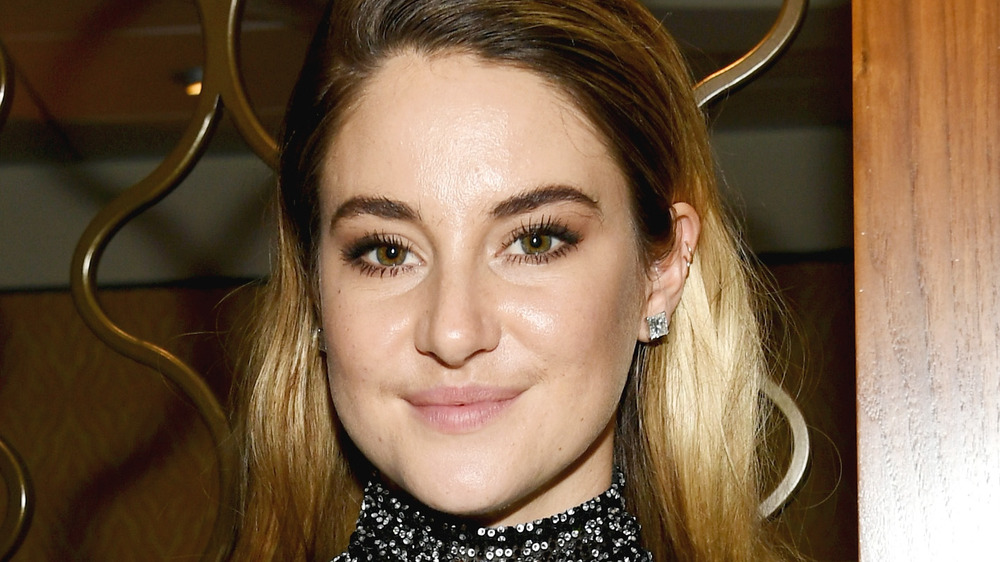 Shailene Woodley poses in a black sparkly blouse