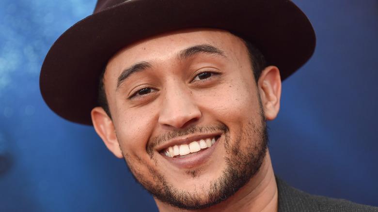 Tahj Mowry smiles at camera