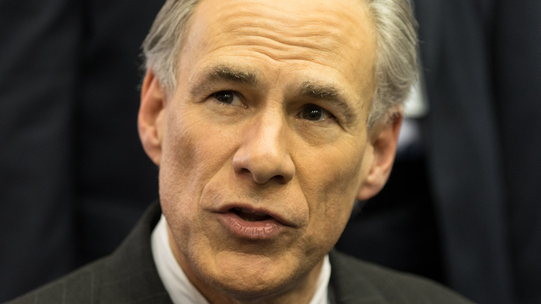 Texas Governor Greg Abbott speaks to the media before the Republican National Committee in 2016