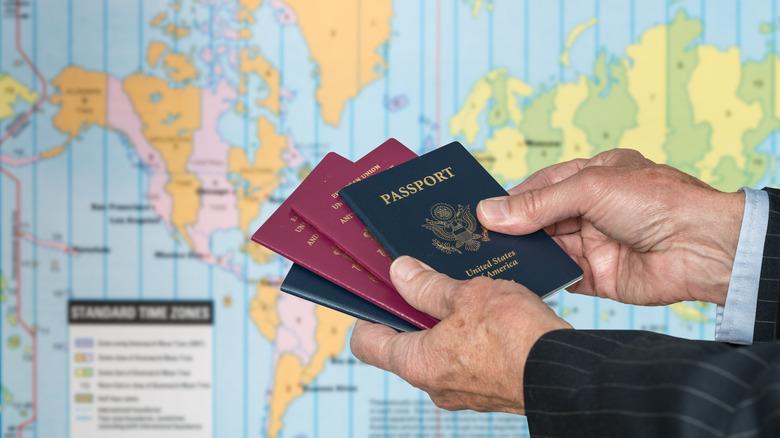 Hands holding UK and USA passports