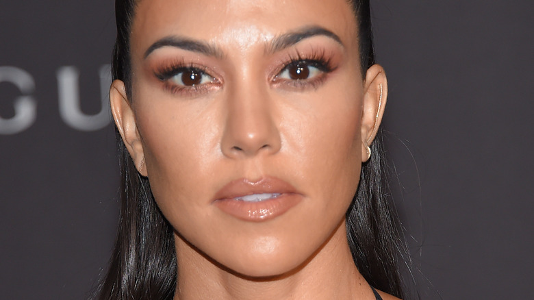 Kourtney Kardashian, posing