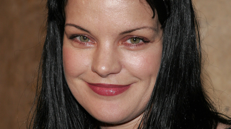Pauley Perrette smiles at an event