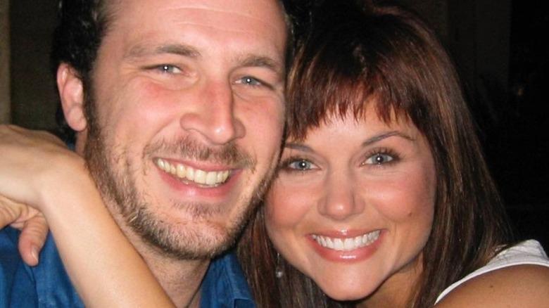 Brady Smith and Tiffani Thiessen smiling