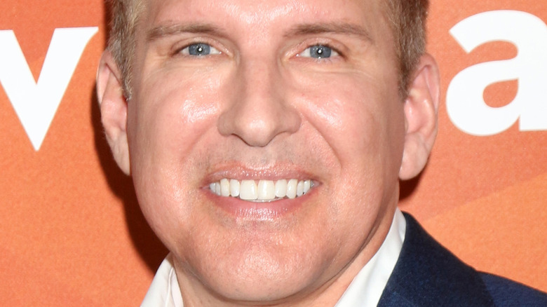 Todd Chrisley smiling at an event